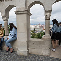 Tourists enjoy the view of the city from the Fishermen's Bastion in the Castle District in Budapest, Hungary on June 19, 2020. ATTILA VOLGYI