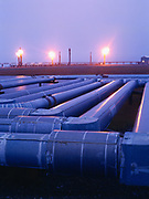 Lines from production pads and flares near Gathering Center 1, BP's side of the Prudhoe Bay Oil Field, North Slope, Alaska.