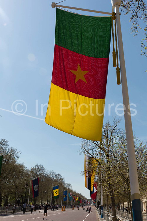 With the flag of Cameroon in the foreground, all the flags of Commonwealth Nations hang along the Mall, from Admiralty Arch to Buckingham Palace on the occasion of the bi-annual Commonwealth Heads of Government Meeting CHOGM,  on 19th April 2018, in London, England.