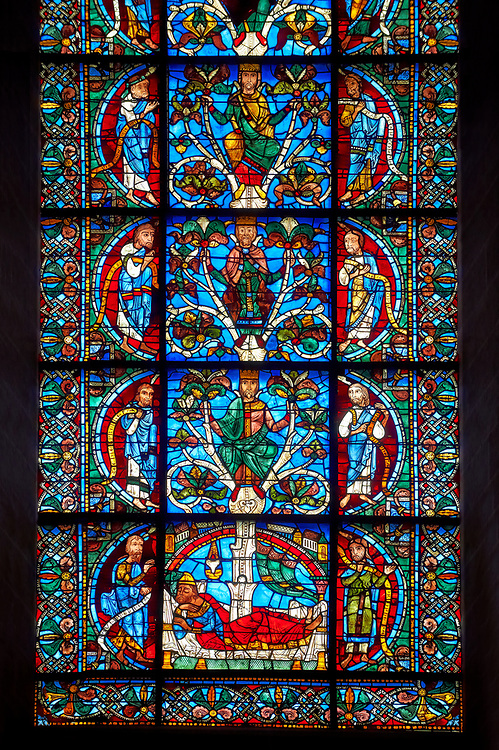 Medieval stained glass Window of the Gothic Cathedral of Chartres, France - dedicated to The Tree of Jesse (12th century). Botton row of panels - Nahum / Jesse with the 'stem' growing from his loins / Joel. row above - Ezekiel / David / Hosea, row above - saiah / Solomon / Micah. Top row - Moses / Generic King of Israel / Balaam. A UNESCO World Heritage Site. .<br /> <br /> Visit our MEDIEVAL ART PHOTO COLLECTIONS for more   photos  to download or buy as prints https://funkystock.photoshelter.com/gallery-collection/Medieval-Middle-Ages-Art-Artefacts-Antiquities-Pictures-Images-of/C0000YpKXiAHnG2k