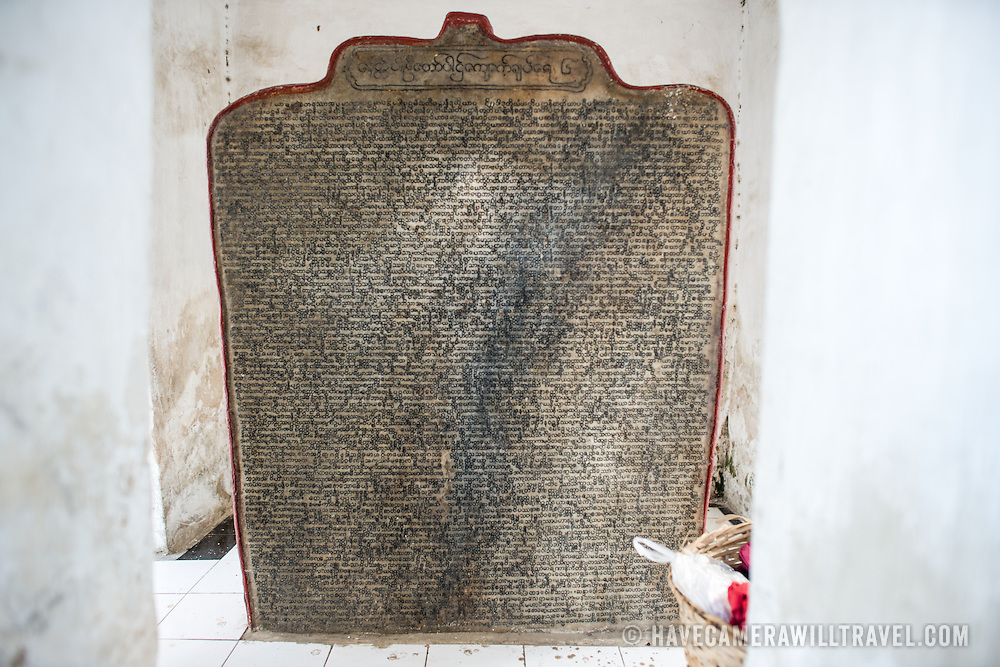 """A """"page"""" of the World's Largest Book. Built by King Mindon in 1857 at the foot of Mandalay Hill, Kuthodaw Pagoda houses what is known as The World's Largest Book, which consists of 729 kyauksa gu or stone-inscription caves, each containing a marble slab inscribed on both sides with a page of text from the Tipitaka, the entire Pali Canon of Theravada Buddhism."""