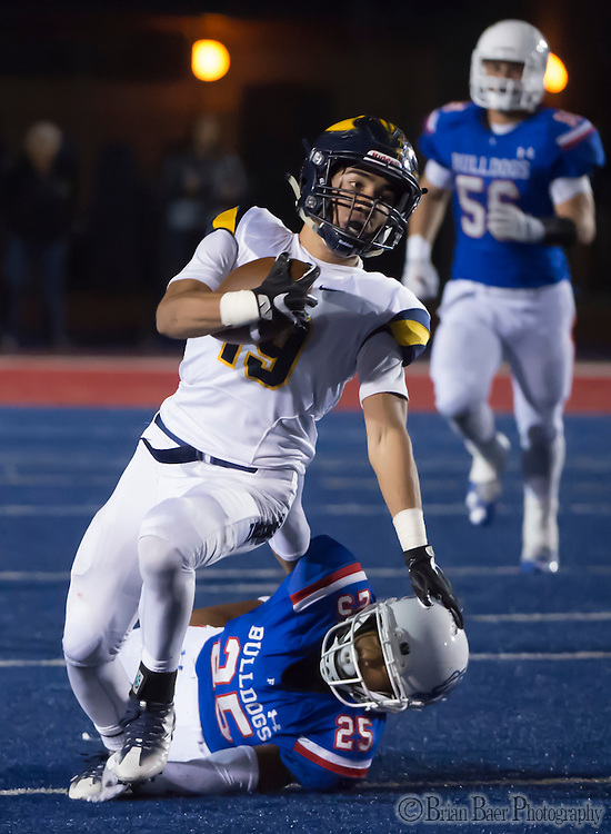 Oak Ridge Trojans Justin Poerio (19), runs with the ball as he is hit by Folsom High School Bulldogs Maurice Gaines (25), during the third quarter as the Folsom High School Bulldogs varsity football team host the Oak Ridge High School Trojans,  Friday Nov 4, 2016.<br /> photo by Brian Baer