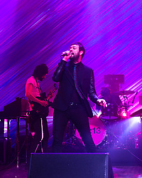 © Licensed to London News Pictures. 01/12/2014. London, UK.   Kasabian performing live at Brixton Academy for the first of five consecutive nights at the venue.   In this picture - Sergio Pizzorno (left), Tom Meighan (right).  Kasabian consists of members Tom Meighan (lead vocals) Sergio Pizzorno (guitar, backing vocals), Chris Edwards (bass), Ian Matthews (drums).  Photo credit : Richard Isaac/LNP