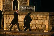 A mourner in tailed jacket and pinstripes, walks towards Windsor Castle's visitor entrance for Princess Margaret's funeral.