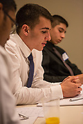 Purchase, NY – 31 October 2014. Yonkers High School student Eric Kantar (center) discussing the case with his team. The Business Skills Olympics was founded by the African American Men of Westchester, is sponsored and facilitated by Morgan Stanley, and is open to high school teams in Westchester County.