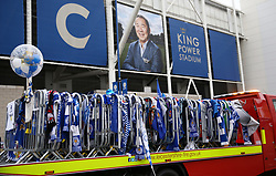 A truck is loaded to relocate the tributes left for the victims of the Helicopter crash at the King Power Stadium, Leicester.
