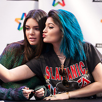 """BLOOMINGTON, MN - JUNE 05: Kendall and Kylie Jenner sign copies of their book, """"Rebels: City of Indra"""" at the Mall of America on June 5, 2014 in Bloomington, Minnesota. (Photo by Adam Bettcher/Getty Images) *** Local Caption ***  Kendall Jenner; Kylie Jenner"""