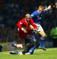 Photo Aidan Ellis.<br />Everton v Liverpool.<br />FA Barclaycard Premiership.<br />30/08/2003.<br />Liverpool's El Hadji Diouf and Everton's Mark Pembridge and Gary Naysmith