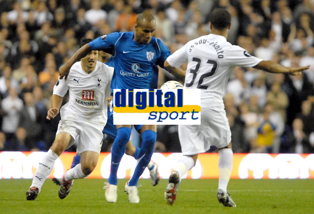 Photo: Ed Godden/Sportsbeat Images.<br /> Tottenham Hotspur v Anorthosis Famagusta. UEFA Cup, First Leg. 20/09/2007. Famagusta's William Boaventura (C), makes his way past Steed Malbranque (L) and Benoit Assou-Ekotto (R).