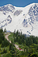 Mount Rainier and High Hut of the Mount Tahoma Trails in the Tahoma State Forest, Cascade Mountain Range, WA USA with a Department of Natural Resources vehicle patrolling the forest.