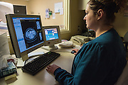 CT scan model Dr. Ted Steinbock and operator of CT scan, Mandy Hatton, photographed Wednesday, May 27, 2015 at Baptist Health in Louisville, Ky. (Photo by Brian Bohannon/Videobred for Baptist Health)
