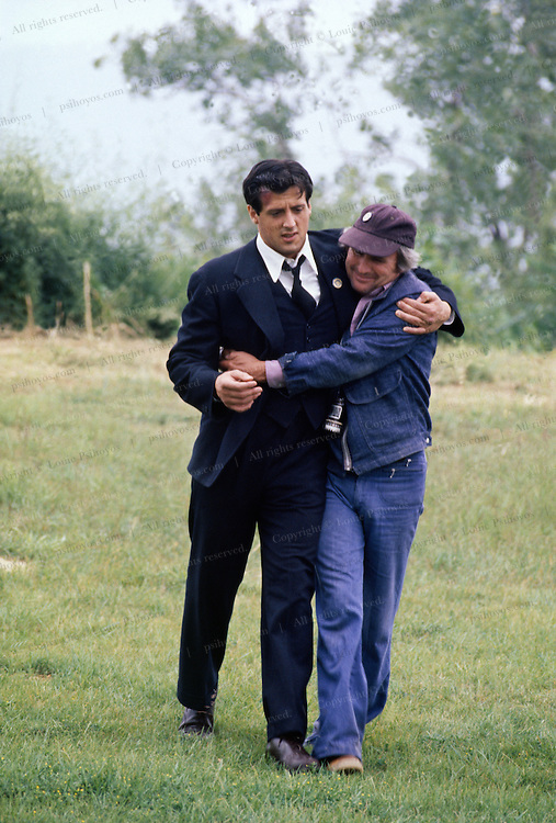 Sylvester Stallonefilming the movie F.I.S.T., a depression-era epic in town of Dubuque, Iowa.  The Director Norman Jewison gives Stallone a hug after an emotional scene in a cemetery.