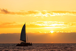 Sunset and a sailboat of the Napali Coast of the Hawaiian Island of Kauai