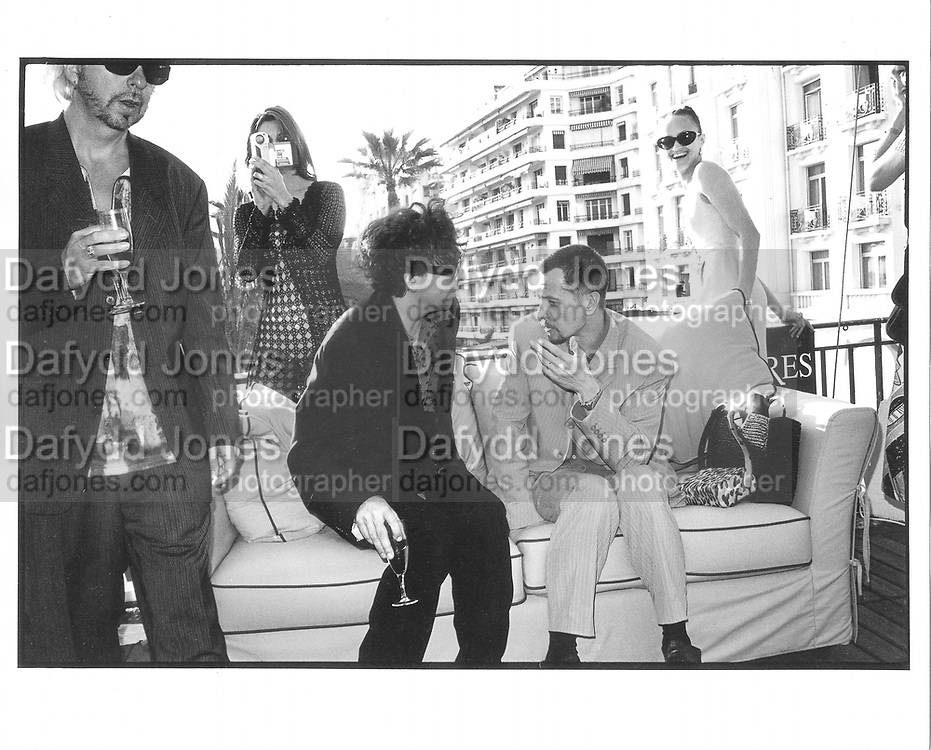 Tim Burton, Gary Oldman, Lisa Marie cocktails, Martinez Hotel, Cannes Film festival 10th May1997© Copyright Photograph by Dafydd Jones 66 Stockwell Park Rd. London SW9 0DA Tel 020 7733 0108 www.dafjones.com