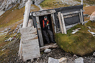 Polar traveller Liisa Widstrand checks out the Trappers cabin at Gnälodden, Svalbard, Norway, Arctic