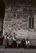 Romania.Humore.  painted monastery and peasants         / monastère peint  et villageois  Humore  Roumanie costume soeur en priere  interieur et exterieur/ monaster de Humore