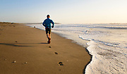 Jeremiah Kahmosen chases the wet line while running Salmon Creek Beach in Sonoma Coast State Park, California