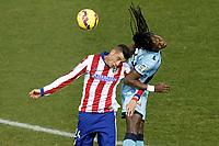 Atletico de Madrid's Jose Maria Gimenez (l) and Rayo Vallecano's Manucho during La Liga match.January 24,2015. (ALTERPHOTOS/Acero)