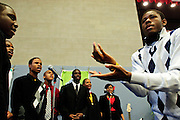 """Christ the King Jesuit College Preparatory School junior Sharieff Robinson, 18 (R), leads the school Gospel Choir singing """"God Made Me"""" during the First Commencement Exercises on Saturday, June 9th 2012.  The institution is a beacon of hope amid one of the city's most impoverished neighborhoods, bucking low graduation rate trends with a 100% graduation and college acceptance rate. Brian J. Morowczynski~ViaPhotos..For use in a single edition of Catholic New World Publications, Archdiocese of Chicago. Further use and/or distribution may be negotiated separately. ..Contact ViaPhotos at 708-602-0449 or email brian@viaphotos.com."""