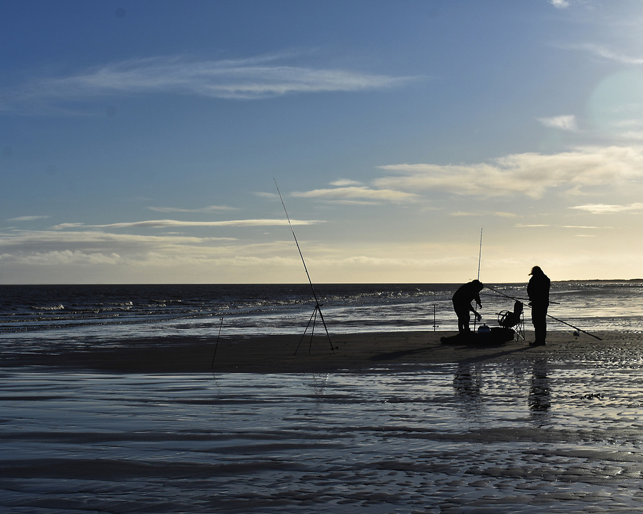 People fishing on Skegness beach as Lincolnshire enters Tier three restrictions in the week before Christmas as the UK continues to endure the Coronavirus pandemic.