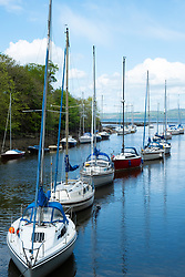 Row of sailing yachts moored on River Almond at Cramond in Edinburgh, Scotland, UK