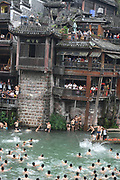 XIANGXI, CHINA - <br /> <br /> Duck Catching Contest<br /> <br /> People catch ducks at Tuojiang River on the Dragon Boat Festival in Fenghuang Ancient Town  in Xiangxi Tujia and Miao Autonomous Prefecture, Hunan Province of China. To celebrate the Dragon Boat Festival (aka Duanwu Festival), local people and tourists jumped into Tuojiang River to catch ducks at Fenghuang Ancient Town <br /> ©Exclusivepix Media