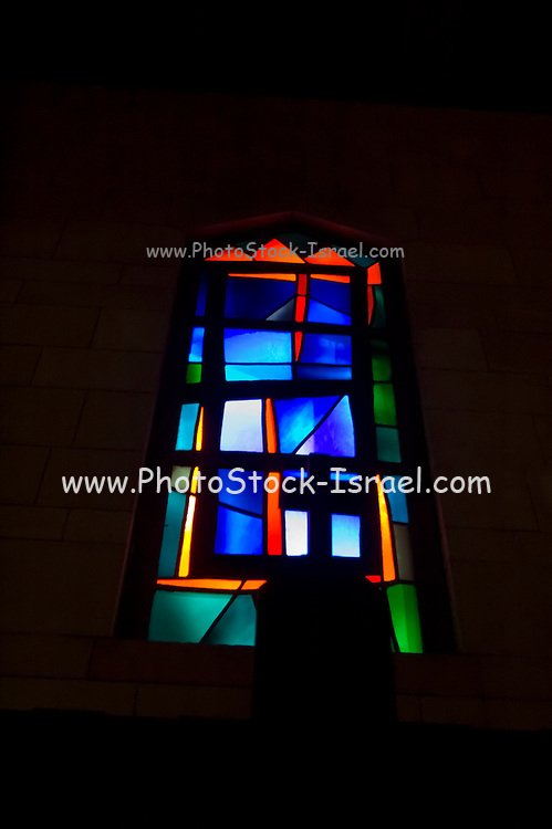 Israel, Nazareth, Basilica of the Annunciation, Stained glass window in the lower level with a silhouette of a cross in the foreground
