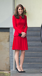 Catherine, Duchess of Cambridge, wearing a red Alexander McQueen dress, during a Christmas party at the Anna Freud Centre in London.