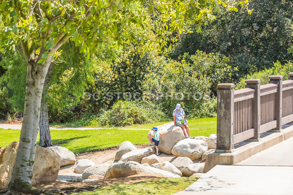Grandparent Watching Grandson Play at Mason Park in Irvine