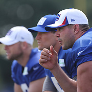 Kicking team Josh Brown, (left), Steve Weatherford, (centre) and Zac DeOssie (right), during the 2013 New York Giants Training Camp at the Quest Diagnostics Training Centre, East Rutherford, New Jersey, USA. 29th July 2013. Photo Tim Clayton.