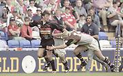 Reading, England, Will GREENWOOD, Tackling during the,  European Shield Final, at the Madejski Stadium, NEC Harlequins v RC Narbonne.<br /> [Mandatory Credit, Peter Spurrier/ Intersport Images].
