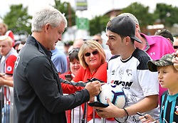 "Southampton manager Mark Hughes meeting fans during a pre season friendly match at Pride Park, Derby. PRESS ASSOCIATION Photo. Picture date: Saturday July 21, 2018. Photo credit should read: Anthony Devlin/PA Wire. EDITORIAL USE ONLY No use with unauthorised audio, video, data, fixture lists, club/league logos or ""live"" services. Online in-match use limited to 75 images, no video emulation. No use in betting, games or single club/league/player publications."