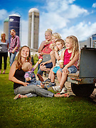 Family enjoying Ice-cream in there dairy farm during a beautiful summer afternoon shot as a Environmental Portraiture on a PhaseOne IQ180