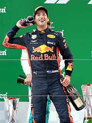 SHANGHAI, April 15, 2018  Red Bull's driver Daniel Ricciardo of Australia celebrates with his shoe on the podium after winning the Formula One Chinese Grand Prix in Shanghai, east China, April 15, 2018. Daniel Ricciardo claimed the title of the event in 1 hour, 35 minutes and 36.380 seconds.  dx) (Credit Image: © Fan Jun/Xinhua via ZUMA Wire)