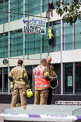 London, UK. 2nd September, 2021. Two climate activists from HS2 Rebellion scale the Tower Place West building in the City of London in protest against the involvement of insurance company Marsh in the HS2 high-speed rail project. Marsh insure subcontractors working on HS2.