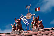 PERU, HIGHLANDS, CUZCO folkart 'toritos' on roofs, good luck