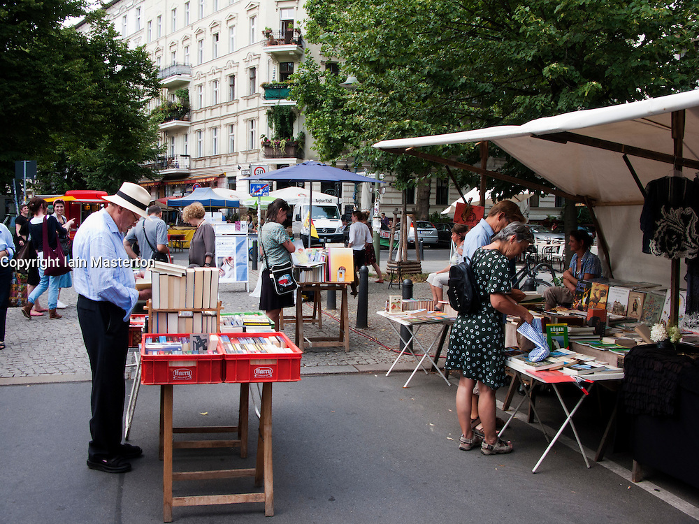 Book stall at outdoor market at Kollwitzplatz in Prenzlauer Berg district of Berlin Germany