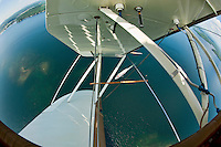 """A """"wingover"""" combined with a """"spiral dive"""" gave us quite the vantage point of the MS Mount Washington cruising on Lake Winnipesaukee from the open cockpit of Pilot Phil DiVirgilio's WACO WMF5C biplane.  (Karen Bobotas/for the Laconia Daily Sun)"""