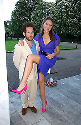 Actor TOM HOLLANDER and DIXIE CHASSAY at a party to celebrate the opening of Roger Vivier in London held at The Orangery, Kensington Palace, London on 10th May 2006.<br /><br />NON EXCLUSIVE - WORLD RIGHTS
