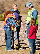 16 MARCH 2010 -- BUCKEYE, AZ: Vickie Eshenbaugh, who was riding Colorado, her husband Mark Eshenbaugh and family friend Alyssa Peterson (CQ) 8, with Colorado near Buckeye Tuesday morning. Colorado has spent the last several days marooned on a sandbar in the middle of the river after he and his owners were nearly swept downstream during a trail ride.   PHOTO BY JACK KURTZ