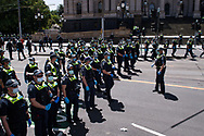 Police encircle protests before arresting them to process and fine them in front the state parliament. The groups who have organised the many Freedom Day protest over the last 3 months, attempted to march to State Parliament on Melbourne Cup Day demanding the sacking of Premier Daniel Andrews for the lockdown and attacks on their civil liberties, where they were met with a heavy police presence.  (Photo by Michael Currie/Speed Media)
