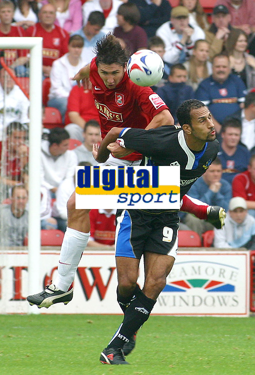 Photo: Dave Linney.<br />Walsall v Macclesfield Town. Coca Cola League 2. 16/09/2006Wasall's .Ian Roper(L) heads clear before   Matty McNeil gets in a challenge.