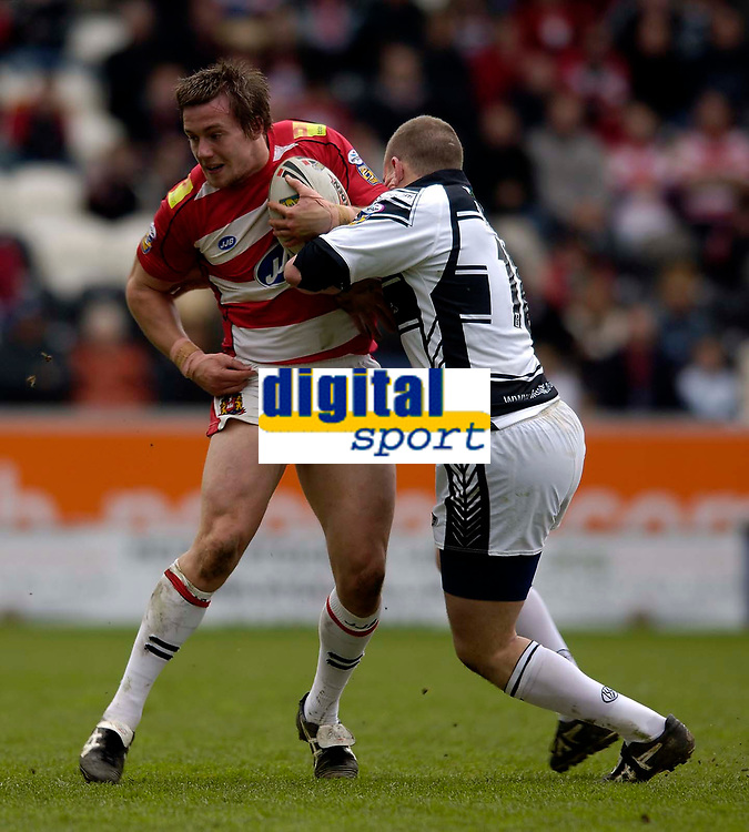 Photo: Jed Wee.<br /> Hull v Wigan Warriors. Engage Super League. 30/04/2006.<br /> <br /> Wigan's Bryn Hargreaves (L) is tackled by Hull's Liam Higgins.