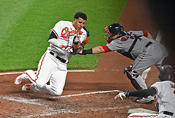 September 19, 2017 - Baltimore, MD, USA - The Baltimore Orioles' Manny Machado, left, is tagged out by Boston Red Sox catcher Christian Vazquez, right, trying to scoring on a single by Jonathan Schoop in the third inning at Oriole Park at Camden Yards in Baltimore on Tuesday, Sept. 19, 2017. The Red Sox won, 1-0, in 11 innings. (Credit Image: © Kenneth K. Lam/TNS via ZUMA Wire)