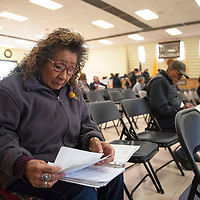 Bertha Etsitty of Shiprock looks over a binder full of  documents she's accumulated since the Gold King Mine spill in 2015 during a meeting for individuals affected by the spill, Thursday morning at the chapter house in Shiprock. Etsitty has been farming an 18.8 acre farm in the area for over 20 years and is one of the plaintiffs in the case.