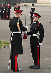 The Duke of Cambridge (left) awards the Sword of Honour to Archibald Hamilton as he represents the Queen as the Reviewing Officer at The Sovereign's Parade at Royal Military Academy Sandhurst in Camberley.