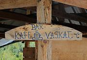Hand written sign for Bar Kafe Vaskat, baths.  Theth, Thethi, Albania. 03Sep15