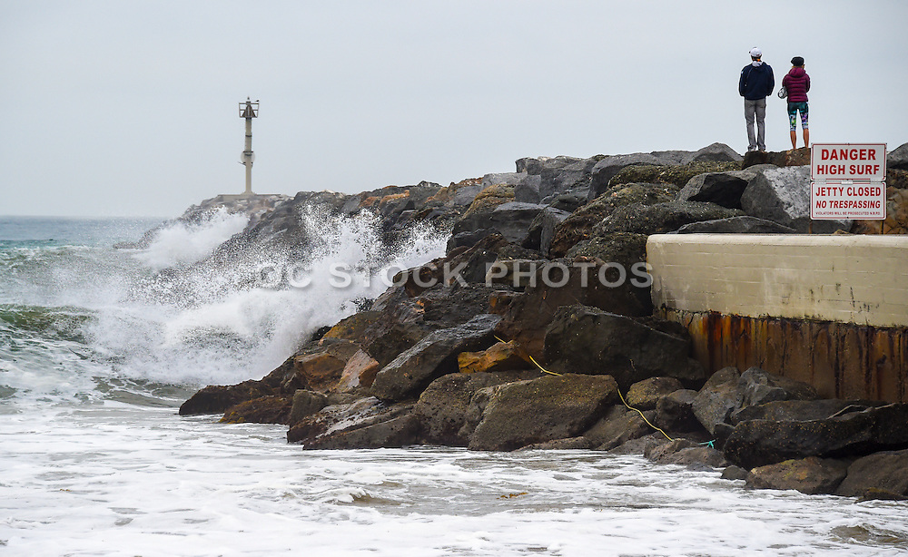 A Couple Watching the Stormy Pacific Ocean at the Wedge in Newport Beach
