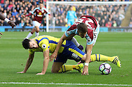 Gareth Barry of Everton and Johann Gudmundsson of Burnley get tangled up as they go for the ball. Premier League match, Burnley v Everton at Turf Moor in Burnley , Lancs on Saturday 22nd October 2016.<br /> pic by Chris Stading, Andrew Orchard sports photography.