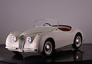 """The Junior Cars that reach speeds of 46mph and cost from £8000 up to £20,000<br /> <br /> <br /> White Roadster starting price £9,995<br /> http://www.youtube.com/watch?v=5GvgjxKY784&feature=youtu.be<br /> <br /> This could be the ultimate toys for rich brats – unless the brat was us, and then it would be absolutely fine.<br /> <br /> Think what you might about a toy car that costs about as much a nicely equipped Mini, these  Junior Cars are absolutely amazing.<br /> <br /> Styled to look like a 1960s classics customers are free to specify the color and trim, much like they would a real Aston. The headlights, indicators, and horn are all fully-functional too.<br /> <br /> The cabin has a wood-rimmed steering wheel, while the seats can be ordered in vinyl or leather trim. If you think that's insane, then take a look at the Junior cars performance specs!<br /> <br /> This isn't some pedal-powered contraption, not by a long shot. Under the tiny hood is a 110cc gasoline-fed engine which features key-operated starting, and comes mated to a 3-speed semi-automatic transmission. According to Nicholas Mee & Co., the London-based Aston Martin dealer offering the DB Junior, this wee toy car can hustle its way to a top speed of 46 mph.<br /> <br /> Yep, Junior could just about get his first taste for highway driving in this thing! The top speed can<br /> <br /> be adjusted downwards, however.<br /> <br /> There's good news for those who are young at heart – these cars has room for a full-size adult.<br /> <br /> """"We regularly have enquiries from our clients looking for something unusual and different to add to their collection of classics,"""" said dealership manager Benja Hedlet of Pocket Classics.co.uk<br /> <br /> Specifcations<br /> <br /> In standard tune the cars reach 45mph (72 kph). This can be restricted for younger drivers. Owners may modify the cars to reach speeds in excess of 80 mph (128 kph). The cars in standard tune use approx. 1.5 litres an hour.<br /> <br /> Leng"""
